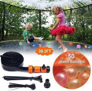 Little boy and a girl playing in the trampoline with water spray