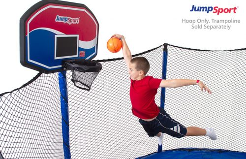 The boy jumping and throwing basketball at the hoop basket