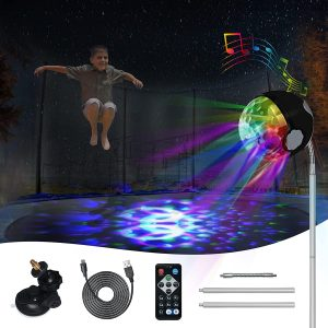 A boy jumping in the air under trampoline party lights