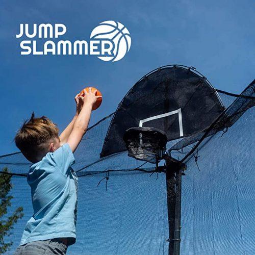 The boy slam dunk the ball
