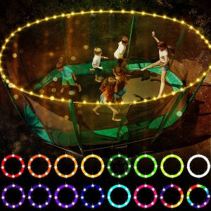 Six kids playing happily together in a trampoline with Waybeleive lights