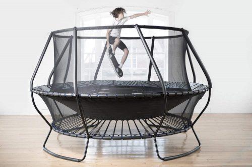 A boy playing bounce board on trampoline