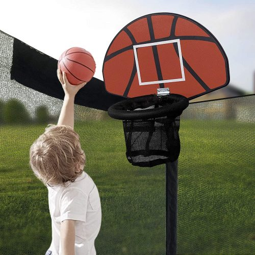 Little boy throwing the basketball to score in the trampoline hoop