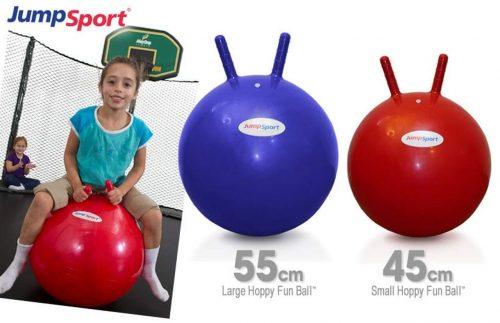 A little girl sitting on the hoppy ball