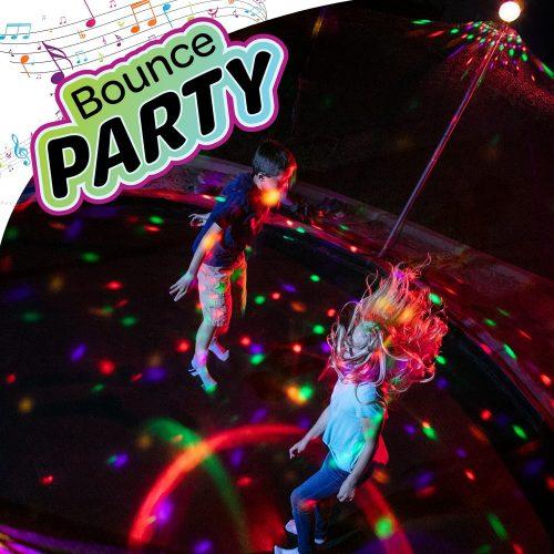 Two kids dancing under music lights in trampoline