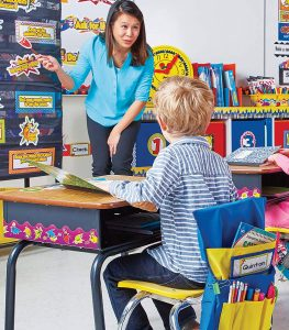 Kid sitting on the chair with seat sack in classroom